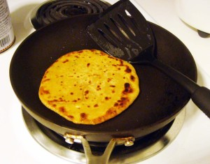 Cook the paratha till it is golden-brown on each side