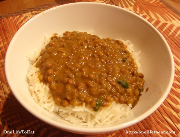 Masoor dal ladled over freshly cooked rice