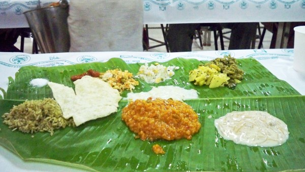 South-Indian wedding food served on a banana leaf