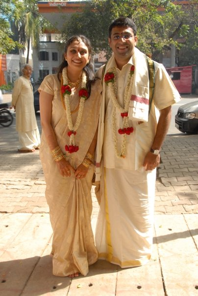 The author and her husband in tradition wedding attire