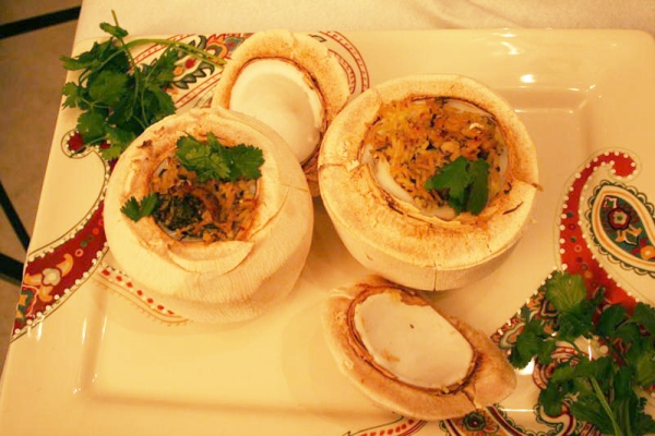 Coconut chicken pilaf cooked in a tender coconut shell