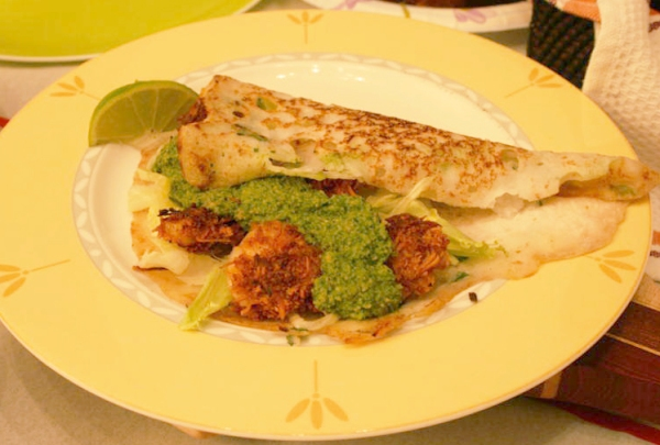 Coconut encrusted shrimp in a rice crepe