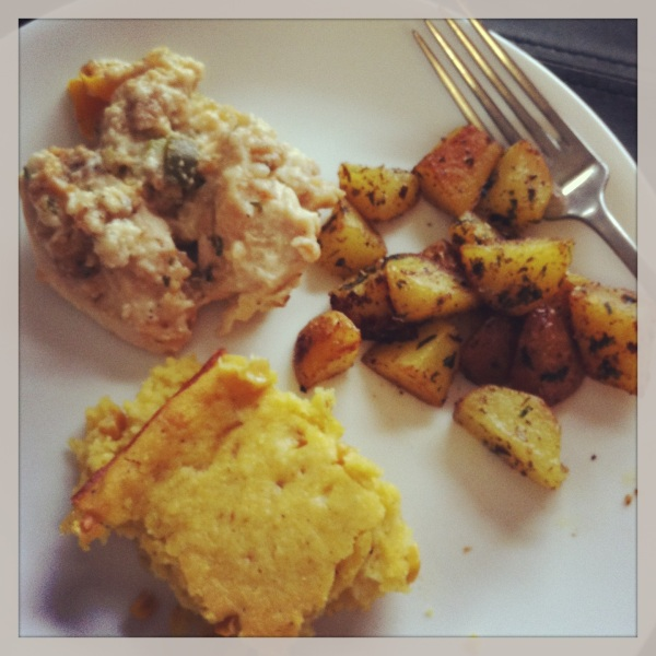 "Baked ""stuffing"" chicken served with creamed corn and baked potatoes"