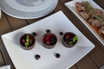 Honey chocolate panna cotta topped with fruit compote